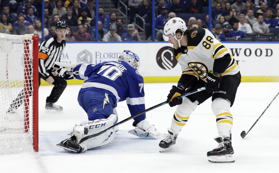 "Lightning goaltender Louis Domingue (70) makes a pad save Bruins right winger David Pastrnak (88) during the first period. ""Kind of whiffed on it,'' Pastrnak admitted."