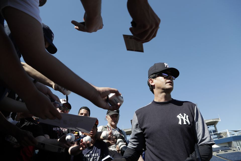 Aaron Boone walks away after signing autographs at spring training last month.