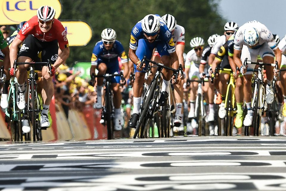Colombia's Fernando Gaviria (center) won the sprint across the line in Stage 4.