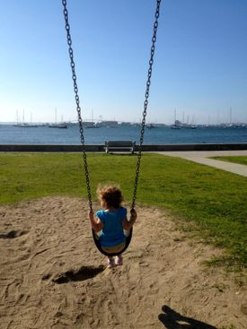 Best view from a swing? At King Park on Newport Harbor.