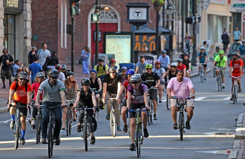 Cyclists ride down Washington Street on National Bike to Work Day, May 19.