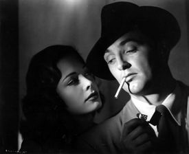 "Robert Mitchum (pictured with Jane Greer in ""Out of the Past"") would have turned 100 next month."
