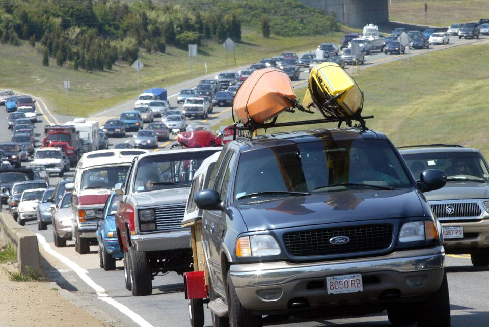 Traffic approaches the Bourne Bridge on Interstate 495 heading onto Cape Cod. On crowded summer weekends, roads are clogged on the Cape, and cellphones stop working.
