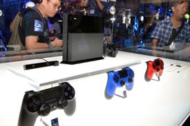 Visitors checked out Sony Computer Entertainment's PlayStation 4 at the Tokyo Game Show in Chiba, near Tokyo, in September.
