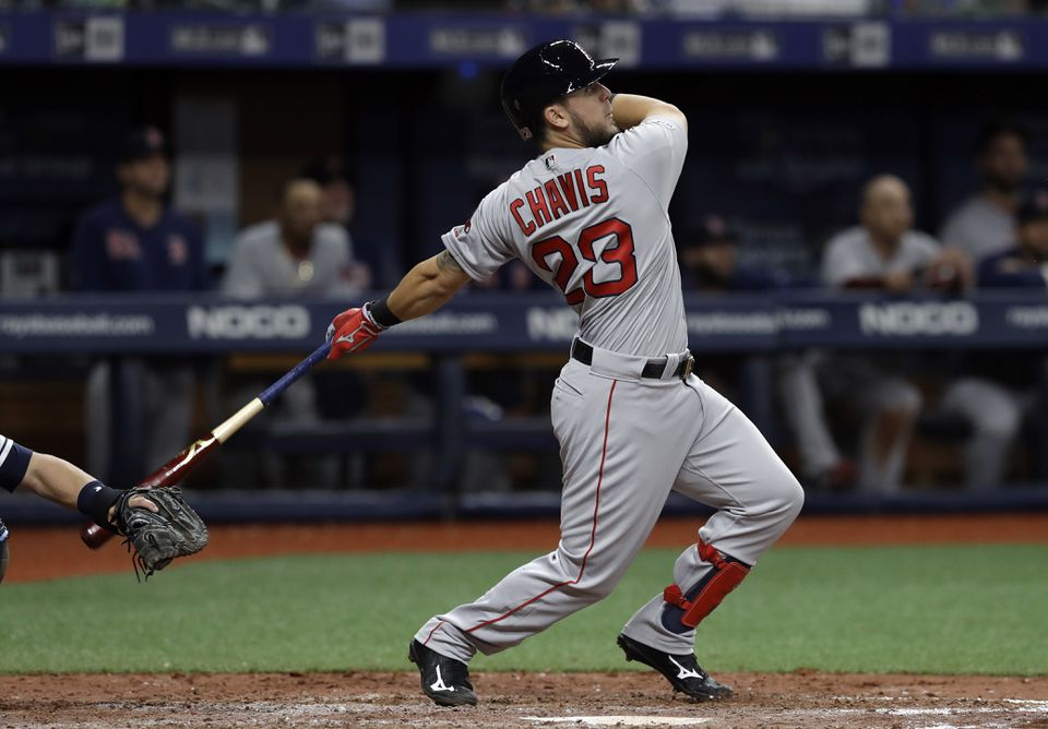 Michael Chavis follows through on a double off Tampa Bay's Jose Alvarado during the ninth inning Saturday.