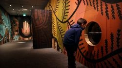 """Nikolay Silkina, 7, checked out """"Where the Questions Live"""" at Peabody Essex Museum."""