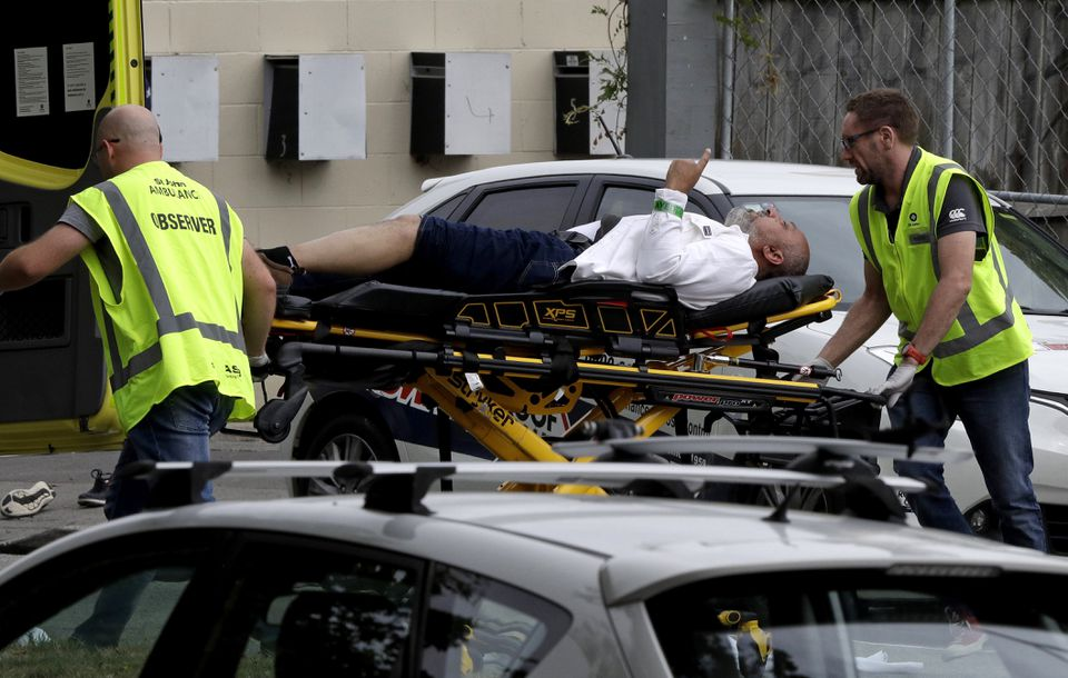 First responders carried a victim away from a Christchurch, New Zealand, mosque after Friday's shooting.