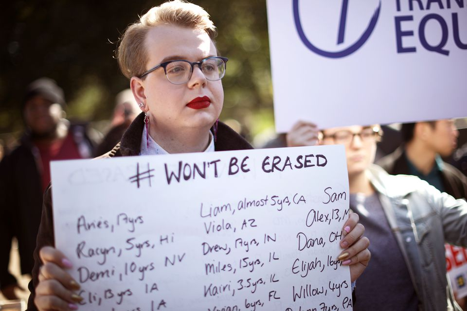 LGBT activists hold signs with the names of transgender people from across the country during a rally in front of the White House on Monday.