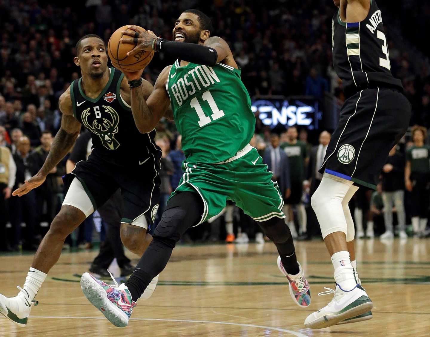 7da4fd3e57d1 The NBA announced Kyrie Irving was fouled by both Eric Bledsoe (left) and  Giannis