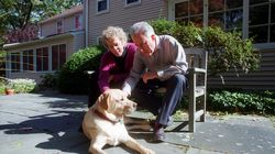 Mr. Reisman at home in Natick with his wife, Paula Lyons, and their dog, in 2003. The couple later moved to Martha's Vineyard, where they became year-round residents.