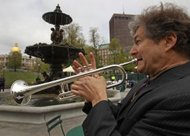 Dana Oakes played at the reopening Wednesday. The Friends of the Public Garden raised money for the plaza restoration.