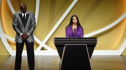 Vanessa Bryant speaks on behalf of Class of 2020 inductee, the late Kobe Bryant, alongside presenter Michael Jordan during the basketball Hall of Fame enshrinement ceremony on Saturday.