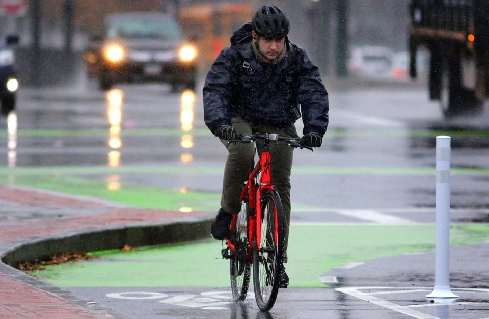 A cyclist rides on Commonwealth Avenuej on Wednesday.