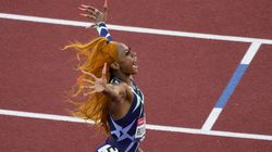 Running as though her hair were on fire, Sha'Carri Richardson exults in her victory in the women's 100 meter final in 10.86 seconds at the US Olympic track and field trials on Saturday in Eugene, Ore.