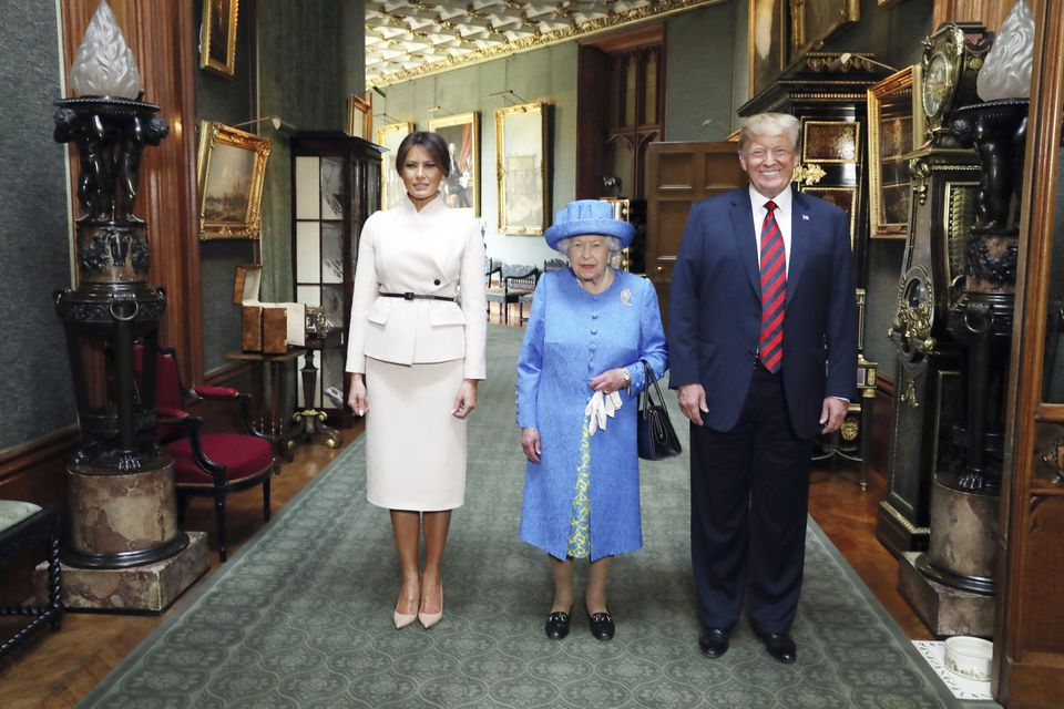 Britain's Queen Elizabeth II, center, posed for a photo with President Donald Trump and his wife, Melania.