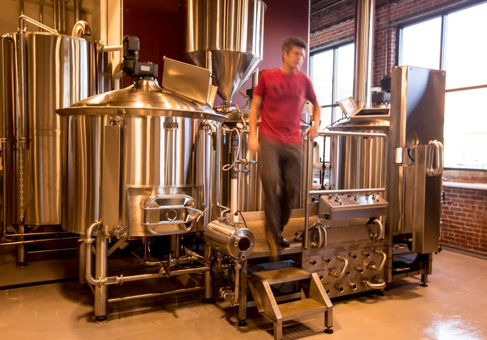 Chris Lohring, founder of Notch Brewing in Salem, doing maintenance work.
