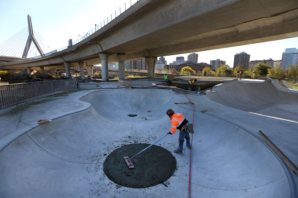 Jesus Guzman worked with cement on the bottom of a pool shape area that will be used by skate boarders.