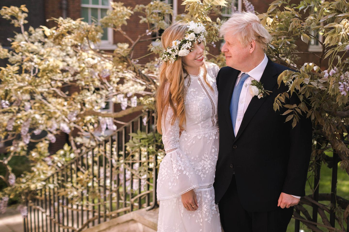 Prime Minister Boris Johnson posed with his wife Carrie Johnson in the garden of 10 Downing Street following their wedding at Westminster Cathedral, May 29, 2021 in London, England.