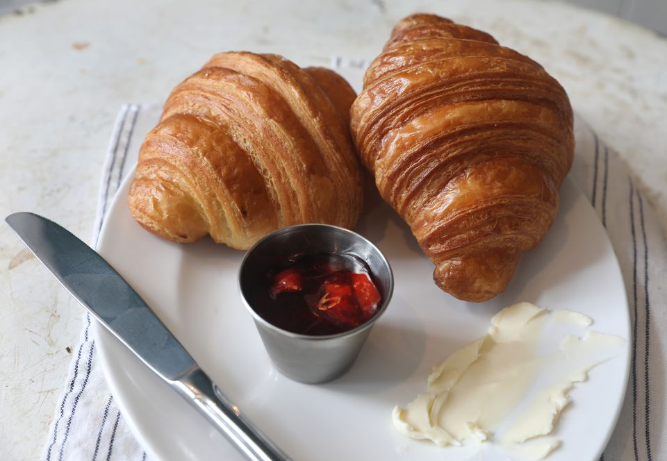 Plain croissant with strawberry jam and butter at Tatte