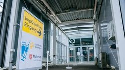An empty entrance awaits people to be vaccinated against COVID at a vaccination center adjacent to Stuttgart Airport at 'Landesmesse Stuttgart' on July 14 in Stuttgart, Germany. As of today people traveling from Stuttgart Airport can receive a vaccination shot by presenting their airline boarding pass. Localities across Germany are pursuing a variety of means to entice more people to be vaccinated. While the pace of vaccinations remains strong, authorities are seeking to encourage people who so far have not made it a priority to get a first jab.