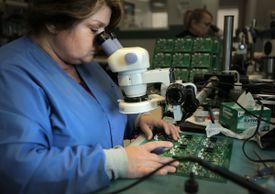 Joanne MacDonald inspected a circuit board at Lightspeed.