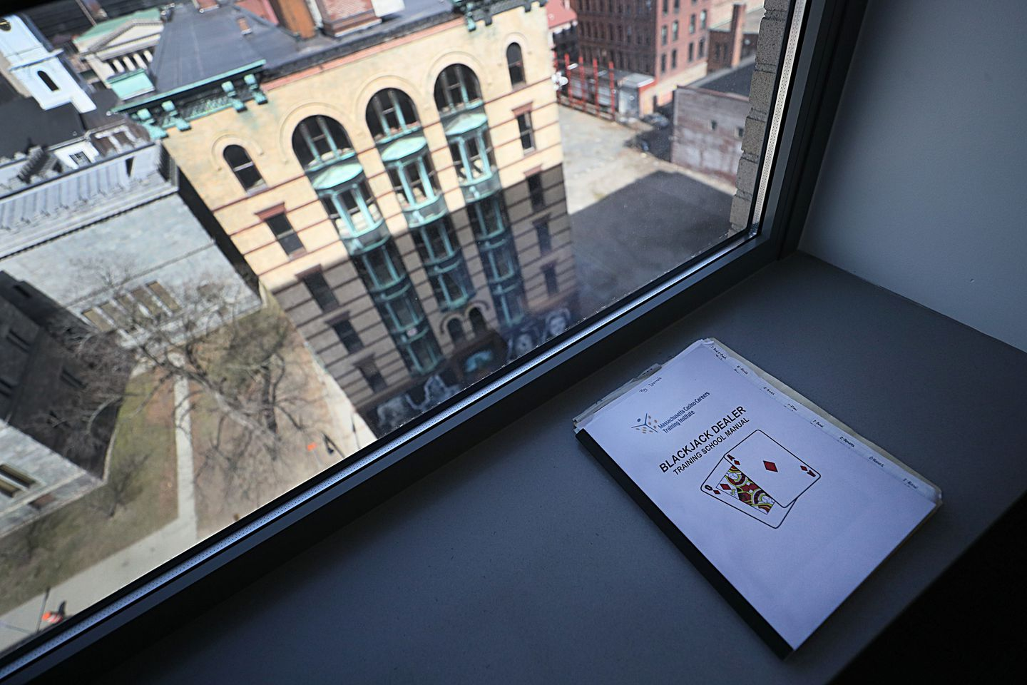 A blackjack manual in a window overlooking downtown Springfield.