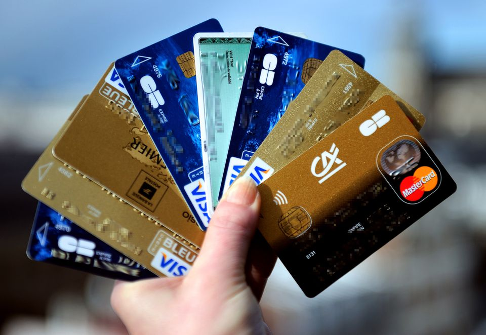 A person held up credit cards.