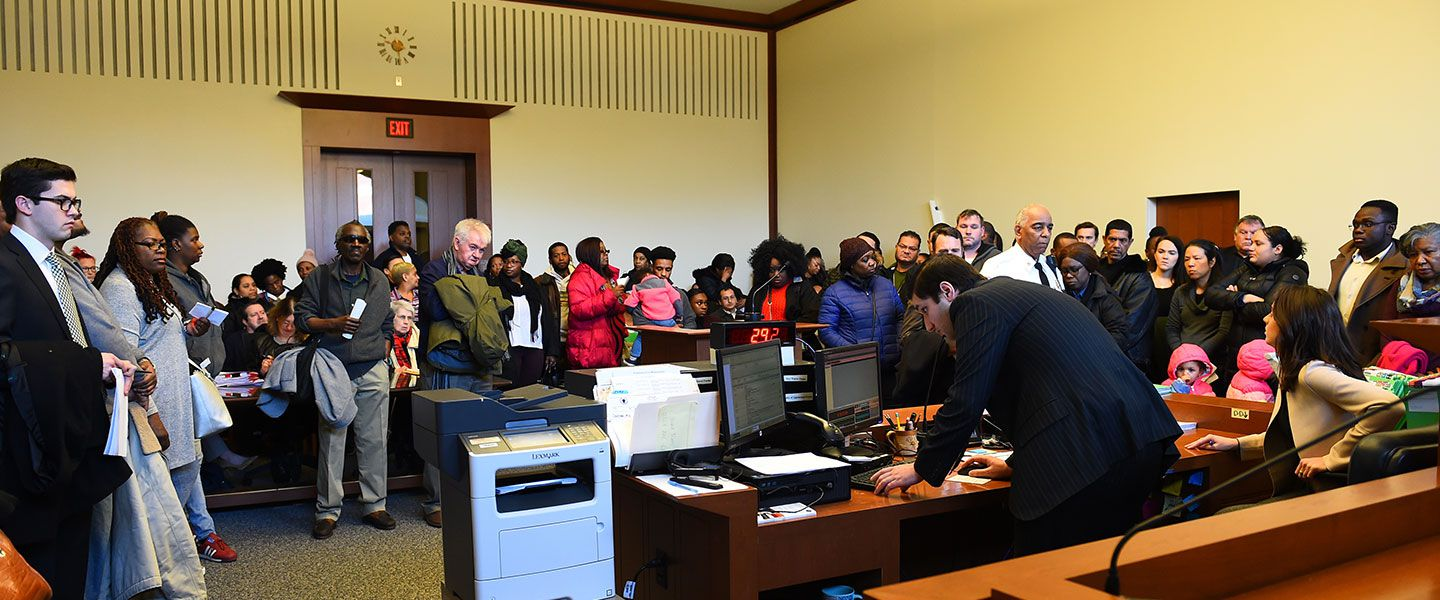 Tenants, landlords, and attorneys wait to hear their cases called in Courtroom 10 in Eastern Housing Court in Boston.
