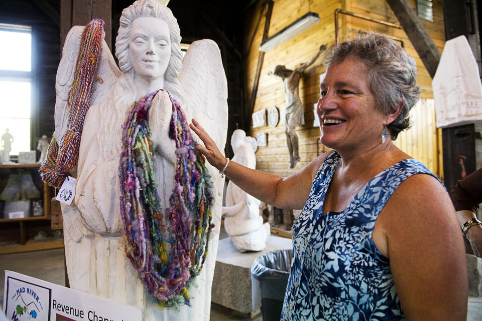 Vee Lynch of Mad River Woolery stood with her work draped over a statue during the Central Vermont Road Pitch at the Vermont Granite Museum in Barre, Vt.