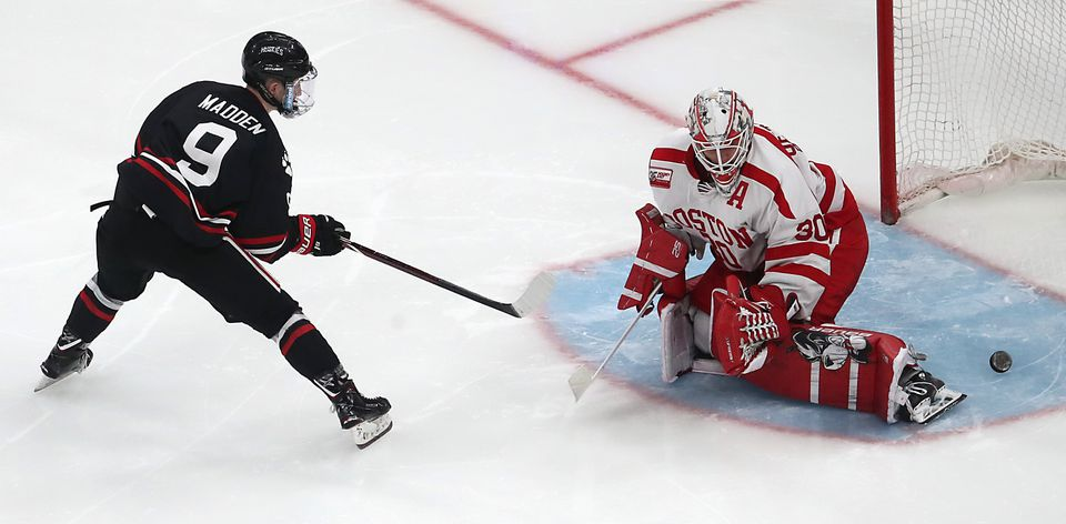 BU goalie Jake Oettinger can't glove a shot by Northeastern's Tyler Madden in overtime, giving a 2-1 win to the defending Beanpot champs.