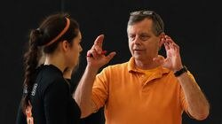 """Richard Barton guided the Newton North girls' volleyball team to state championships in 2014, 2017, and 2018. """"He had so much belief in us as these teenage kids that we could actually win championships,"""" said former player Emma Tavolieri."""